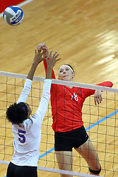 28 September 2014:  Kaitlyn Early taps the ball past Tathianna Cordero during an NCAA womens volleyball match between the Evansville Purple Aces and the Illinois State Redbirds at Redbird Arena in Normal IL