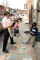 With the Canal Street sidewalk as their canvas  Frates Creative Arts students fill the concrete with their colorful, chalk creations April 8, 2011.