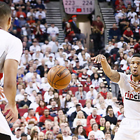 25 April 2016: Portland Trail Blazers guard Damian Lillard (0) passes the ball Portland Trail Blazers guard C.J. McCollum (3) during the Portland Trail Blazers 98-84 victory over the Los Angeles Clippers, during Game Four of the Western Conference Quarterfinals of the NBA Playoffs at the Moda Center, Portland, Oregon, USA.