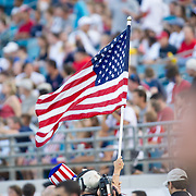 May 26 2012: A fan waves the America flag during pre game of the U.S. Men's National Soccer Team game against Scotland at Everbank Field in Jacksonville, FL. At halftime USA lead Scotland 2-1.