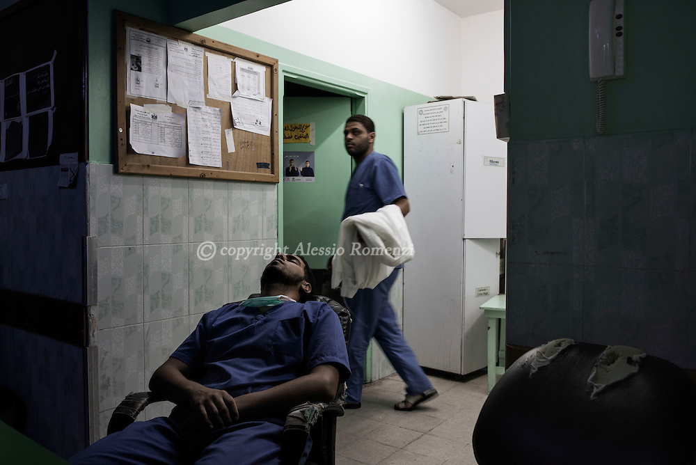 Gaza Strip, Beit Lahyia: An exhausted Palestinian nurse takes a break after the night shift in the Beit Lahya hospital emergency room. ALESSIO ROMENZI