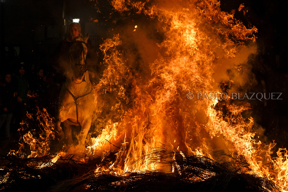 2018/01/16. SAN BARTOLOME DE PINARES, SPAIN - JANUARY 16: A man rides a horse through a bonfire during 'Las Luminarias' Festival on January 16, 2017 in San Bartolome de Pinares, in Avila region, Spain. In honor of Saint Anthony the Abbot, the patron saint of animals, horses are ridden through the bonfires on the night before the official day of honoring animals in Spain. The tradition, which is hundreds of years old, is meant to purify and protect the animal in the coming year. (Photo by Pablo Blazquez Dominguez)