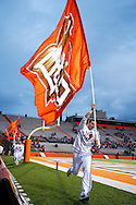 October 3, 2009:  BGSU cheerleader runs down the field with a flag after the BG Falcons scroe during the NCAA footbal game game between Ohio Bobcats and BGSU Falcons atDoylt Perry Stadium in Bowling Green, Ohio