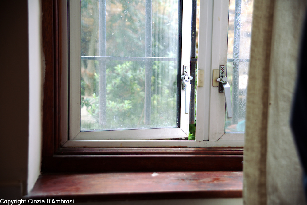 Daniel's room has a window which cannot be opened because of the iron bars. The room is below the yard. Daniel.