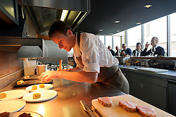 Chef Pieter Lonneville prepares food at Tête Pressée  (Koningin Astridlaan 100 ; 32-470-21-26-27 ; tetepressee.be ). Avoid restaurants in the historic old town where prices and quality reflect a reliance on tourists rather than repeat customers. Instead, head to this  stylish lunch-only eatery (with an adjacent deli selling take-away prepared food) that opened in July 2009, in the residential neighborhood of Sint-Michiels . One hint that this place is intended for locals: the menu is only in Dutch. Take a seat at the long counter framing the open kitchen anyway, because the friendly chef Pieter Lonneville will happily translate.  But really, you can't go wrong with anything on the three-course prix-fixe menu (33 euros ). (Photo © Jock Fistick)
