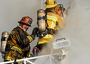 LOS ANGELES, CA. NOVEMBER 15, 2006. <br /> A fire broke out on the second floor of a barber shop on the 4600 block of western ave. in Los Angeles, CA. on November 15, 2006. More than 100 firefighters battled the fire for over four hours. Spot News, General News images for Newspapers by Photojournalist Pablo Robles.