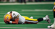 Brett Favre after failing to compete a pass on third down. The Packers had the ball on the one yard line on first down and were pushed back to the ten yard line. They ended up with a field goal. Fourth quarter. WSJ./Apps.