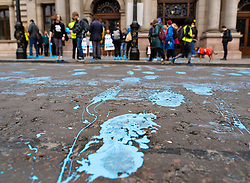 Glasgow, Scotland, UK. 21 March, 2019. A  'Blue Wave' demonstration by the Extinction Rebellion climate change protest group saw protesters make blue footprints, made from water-soluble paint, across George Square to the City Chambers. The peaceful protest briefly held up traffic. The Group aims to highlight threat of rising water levels in the River Clyde and of global climate change. Street covered in blue footprints.