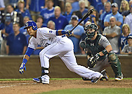 Sep 30, 2014; Kansas City, MO, USA; Kansas City Royals Catcher Salvador Perez (13) hits a walk off single to beat the Oakland Athletics in extra innings during the 2014 American League Wild Card playoff baseball game at Kauffman Stadium. Mandatory Credit: Peter G. Aiken-USA TODAY Sports