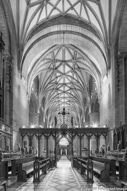 Rood screen and nave looking west from the choir. Tewkesbury Abbey, Gloucestershire, UK. One of the finest examples of Norman architecture in Britain. Built 1121-1530