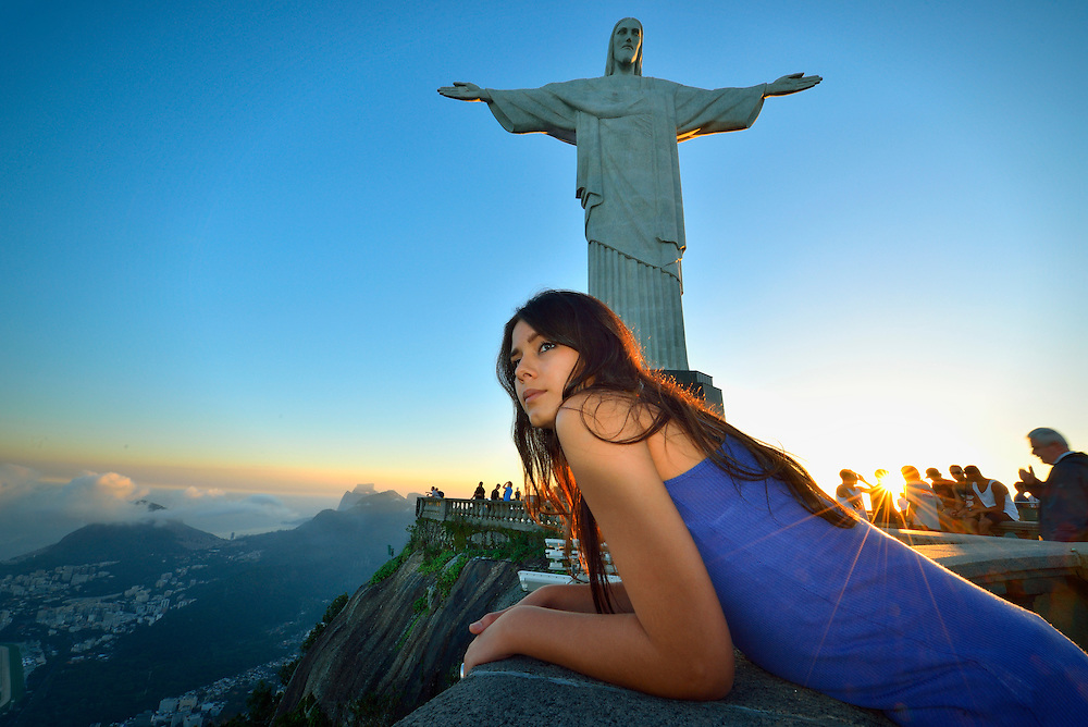 Brazilian girl on corcovado with Christo statue, Rio de Janeiro, Brazil, South America<br /> Model release 0346