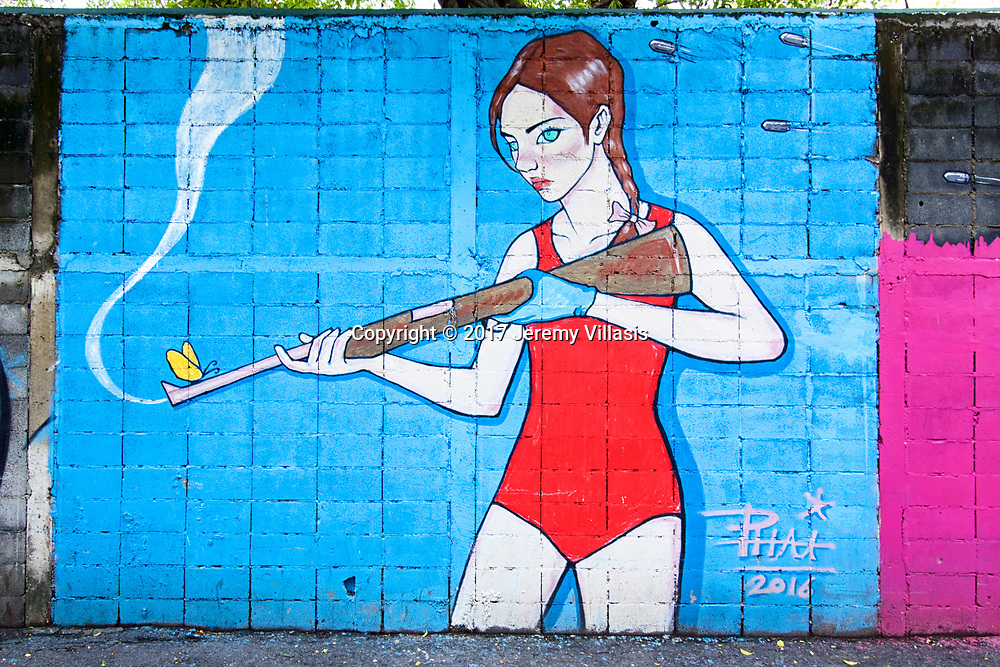Girl with a shot gun by Phai (Thailand), Charoen Krung 32