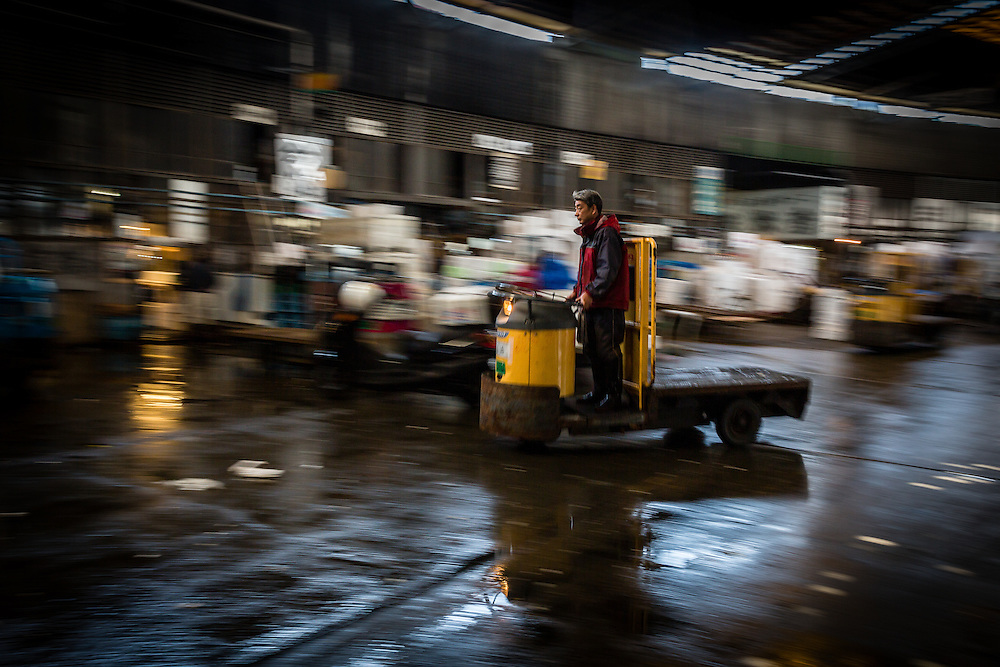 Panning of one of the many transport carts that speed by on Tsukiji Fish Market.