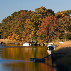 Boats moored in the Lieutenant River in fall in Old Lyme, Connecticut.  Connecticut River tributary.