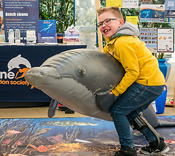 Dynamic Earth, Edinburgh, Scotland, United Kingdom, 9 April 2019. Edinburgh Science Festival:  Jamie Carter, age 8 years, has fun learning about plastic pollution in the sea at Scrapbook: Fight Ocean Plastics from the Skies at Dynamic Earth at the Edinburgh Science Festival. <br /> Sally Anderson | EdinburghElitemedia.co.uk