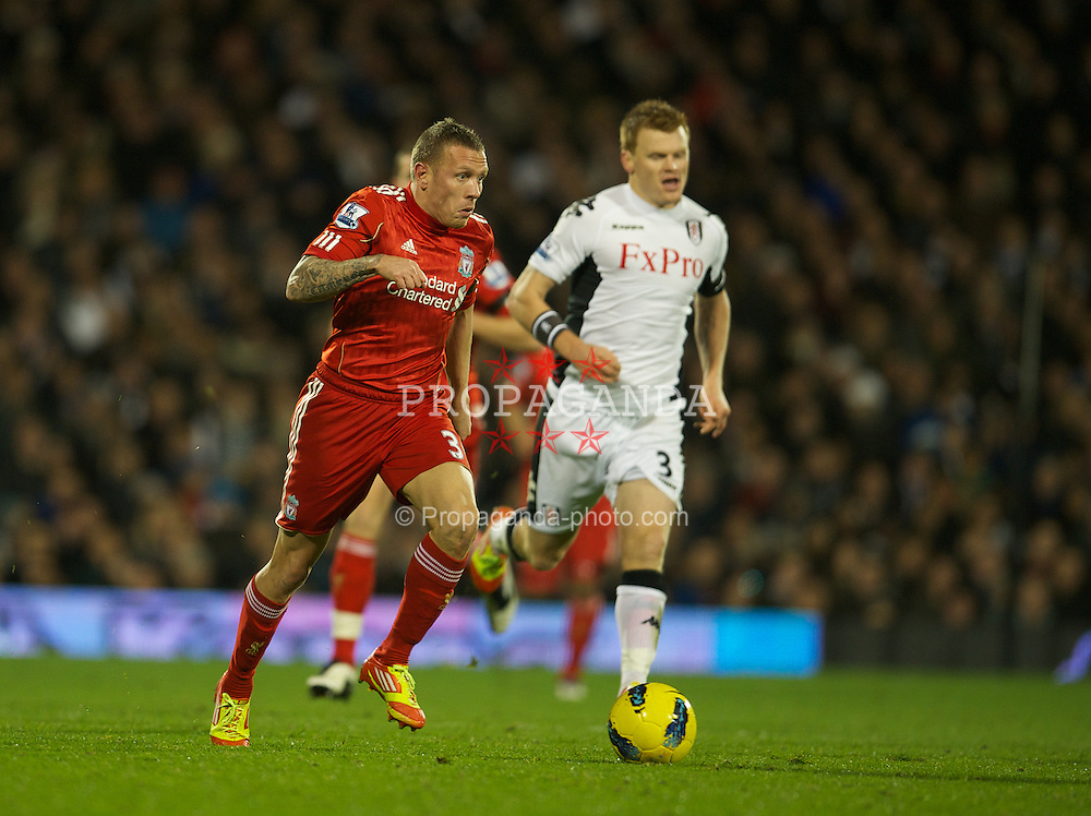 LONDON, ENGLAND - Monday, December 5, 2011: Liverpool's Craig Bellamy and Fulham's John Arne Riise during the Premiership match at Craven Cottage. (Pic by David Rawcliffe/Propaganda)