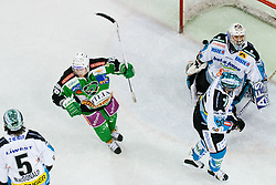 Ales Music (HDD Tilia Olimpija, #16) celebrates while puck is in the net behind Alex Westlund (EHC Liwest Linz, #32) during ice-hockey match between HDD Tilia Olimpija and EHC Liwest Black Wings Linz at fourth match in Semifinal  of EBEL league, on March 13, 2012 at Hala Tivoli, Ljubljana, Slovenia. (Photo By Matic Klansek Velej / Sportida)