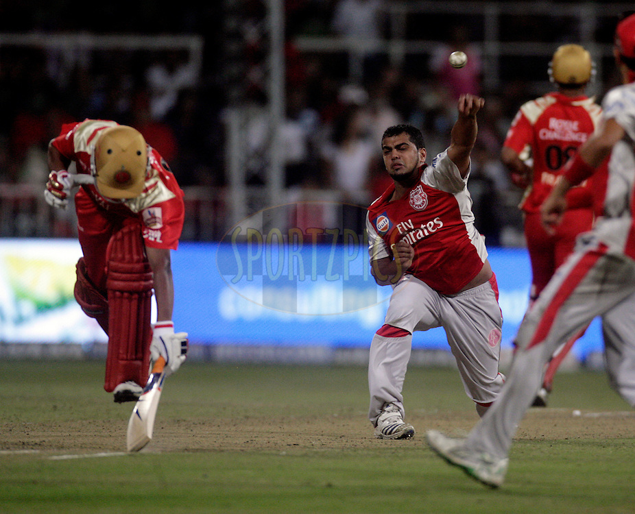 DURBAN, SOUTH AFRICA - 1 May 2009. Yusuf Abdulla takes a shy at the stumps during the IPL Season 2 match between Kings X1 Punjab and the Royal Challengers Bangalore held at Sahara Stadium Kingsmead, Durban, South Africa..