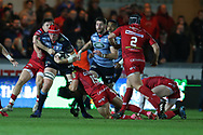 Seb Davies  of Cardiff Blues &copy; is stopped by Steff Evans and Leigh Halfpenny &reg; of the Scarlets. Guinness Pro14 rugby match, Scarlets v Cardiff Blues  at the Parc y Scarlets in Llanelli, West Wales on Saturday 28th October 2017.<br /> pic by  Andrew Orchard, Andrew Orchard sports photography.