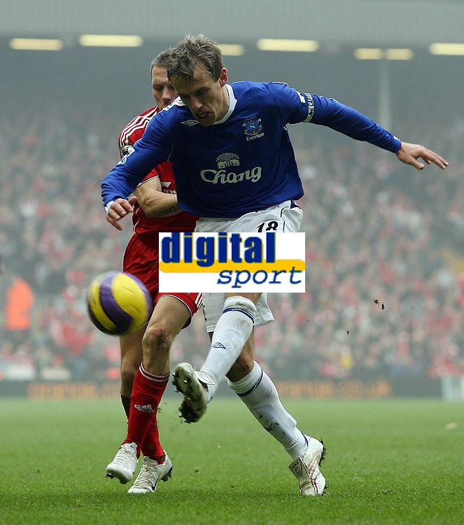 Photo: Paul Thomas.<br /> Liverpool v Everton. The Barclays Premiership. 03/02/2007.<br /> <br /> Phil Neville (R) of Everton clears from Craig Bellamy.