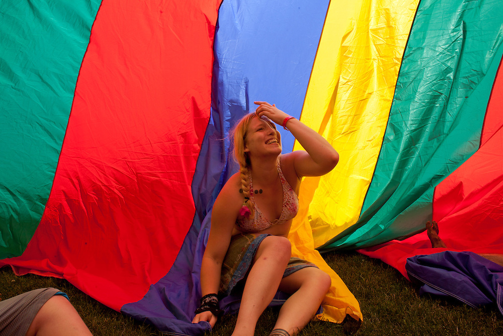 Wendy Lane of Marshalltown plays in a giant parachute on the lawn at Camp Euforia on Friday, July 18, 2015. Jerry Hotz has hosted the annual music fest at his farm north of Lone Tree since 2003.