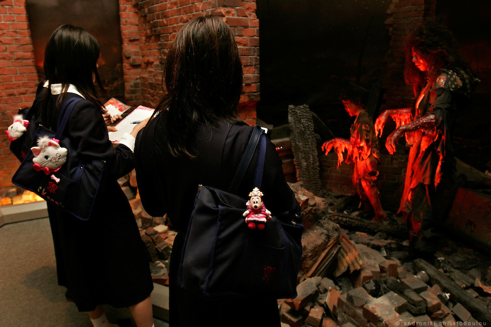 Hiroshima Peace Memorial Museum. Schoolgirls drowing the Reproduction of scenes of Hiroshima after the bombing.