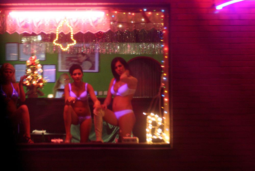 Dubi/Tschechische Republik, CZE, 14.12.06: Prostituierte bieten Ihre Dienste in einem Bordell an der E-55 in der Stadt Dubi (Eichwald) an - Dubi liegt etwa fünf Kilometer nördlich von Teplice direkt an der E55. Einst ein respektierter Kurort, ist die Kleinstadt in den vergangenen 15 Jahren zu einem Eldorado des Sextourismus geworden. <br /> <br /> Dubi/Czech Republic, CZE, 14.12.06: Prostitutes offering their service in a brothel in Dubi at the E-55 highway. Dubi is located five kilometer north from the city of Teplice.