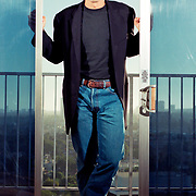 Actor George Clooney poses for a portrait in a high rise hotel in Los Angeles.