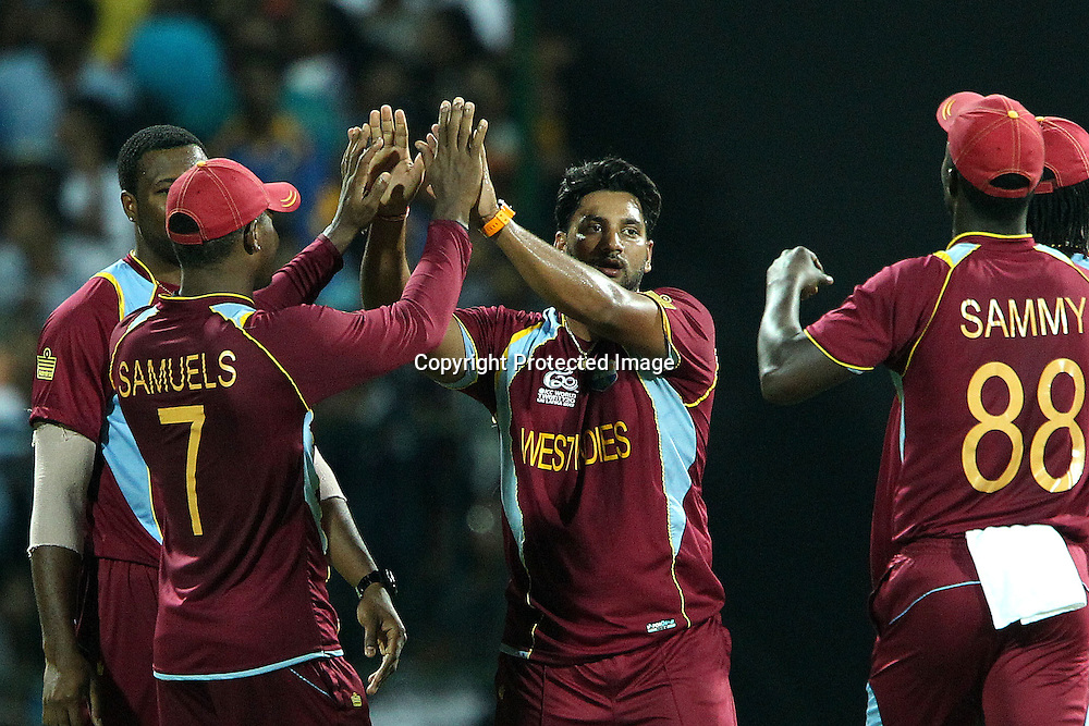 Ravi Rampaul of The West Indies celebrates the wicket of Tilakaratne Dilshan during the ICC World Twenty20 Super 8s match between Sri Lanka and The West Indies held at the  Pallekele Stadium in Kandy, Sri Lanka on the 29th September 2012<br /> <br /> Photo by Ron Gaunt/SPORTZPICS