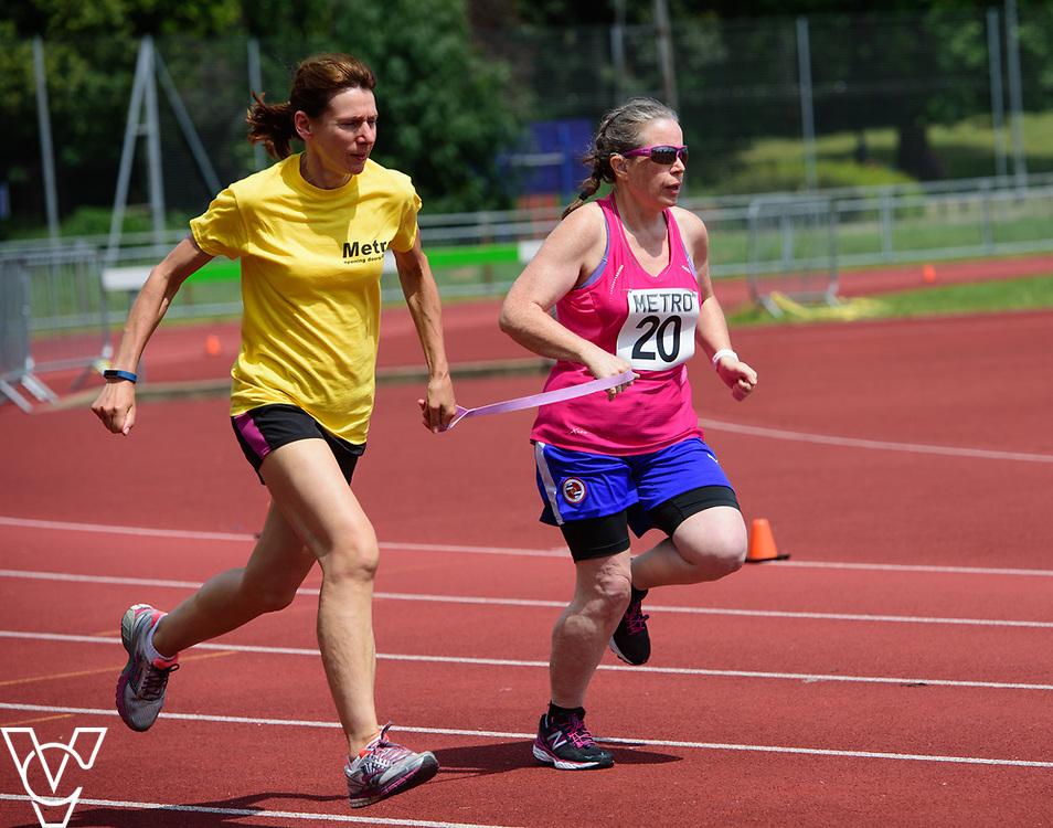 Metro Blind Sport's 2017 Athletics Open held at Mile End Stadium.  200m Senior Women.  Lisa Hendy with guide runner<br /> <br /> Picture: Chris Vaughan Photography for Metro Blind Sport<br /> Date: June 17, 2017