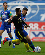 Samy Morsy of Wigan Athletic(5) and Brian Mbeumo(19) of Brentford in action during the EFL Sky Bet Championship match between Wigan Athletic and Brentford at the DW Stadium, Wigan, England on 9 November 2019.