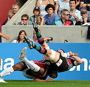 Twickenham, GREAT BRITAIN, Harlequins', Jim EVANS turned over by the tackle from Saracens' Kameli RATUVOU , first half of the  Guinness Premiership match,  Harlequins vs Saracens at The Stoop Stadium, Surrey on Sat. 19.09.2009.  [Photo. Peter Spurrier/Intersport-images]