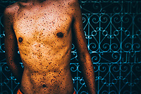 A blood-splattered torso in Pampagna during Holy Week in the Philippines.