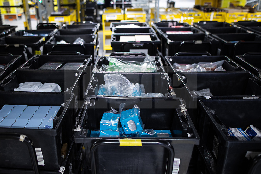 "© Licensed to London News Pictures . 04/12/2019. Manchester , UK . Amazon Echo Dot devices inside the ""MAN1"" Amazon fulfilment centre warehouse at Manchester Airport in the North West of England . Photo credit : Joel Goodman/LNP"