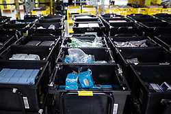"""© Licensed to London News Pictures . 04/12/2019. Manchester , UK . Amazon Echo Dot devices inside the """"MAN1"""" Amazon fulfilment centre warehouse at Manchester Airport in the North West of England . Photo credit : Joel Goodman/LNP"""