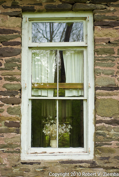 """Dunraven School House Window""-An image of a window in a stone one room school house with reflections."