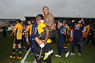 Newport county players Ismail Yakubu and Aaron O'Connor celebrate their win as they book their place in the Wembley final.Blue square bet premier div, play off semi final match, 2nd leg, Newport county v Grimsby Town at Rodney Parade in Newport, South Wales on Sunday 28th April 2013. pic by Andrew Orchard,  Andrew Orchard sports photography,
