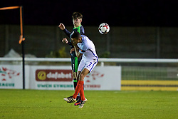 BANGOR, WALES - Saturday, November 12, 2016: Wales' Ben Woodburn in action against England's Trent Alexander-Arnold during the UEFA European Under-19 Championship Qualifying Round Group 6 match at the Nantporth Stadium. (Pic by Gavin Trafford/Propaganda)