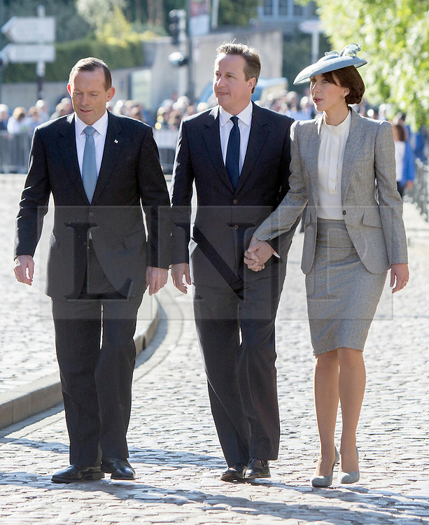 © Licensed to London News Pictures. 06/06/2014. Bayeux, Normandy.  (L-R) Australian PM Tony Abbott, David Cameron and Samantha Cameron join veterans and their guests at the Royal British Legions 70th Anniversary service of the D Day landings in the cathedral at Bayeux this morning.  The majority of the 600 veterans attended the service along with HRH The Queen and Prince Phillip.  Bayeux, Normandy.  Bayeux, Normandy. Photo credit : Alison Baskerville/LNP
