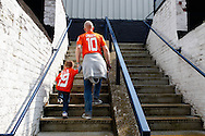 A father with 'Daddy' on the back of his shirt enters the Kenilworth Road stadium ahaead of the Skrill Conference Premier match at Kenilworth Road, Luton<br /> Picture by David Horn/Focus Images Ltd +44 7545 970036<br /> 21/04/2014