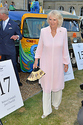 THE DUCHESS OF CORNWALL at the Quintessentially Foundation and Elephant Family 's 'Travels to My Elephant' Royal Rickshaw Auction presented by Selfridges and hosted by HRH The Prince of Wales and The Duchess of Cornwall held at Lancaster House, Cleveland Row, St.James's, London on 30th June 2015.