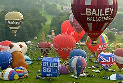 © Licensed to London News Pictures. 10/08/2012. Bristol, UK. Mass early morning balloon ascent at the Jones Lang LaSalle Bristol International Balloon Fiesta, which runs from 09-12 August at Ashton Court in Bristol.  This year's fiesta is sponsored by Jones Lang LaSalle. 10 August 2012..Photo credit : Simon Chapman/LNP