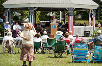 Town Moderator Sandy McGonagle reads a poem during the Gilford Bicentennial festivities at the Village Field on Saturday morning.  (Karen Bobotas/for the Laconia Daily Sun)