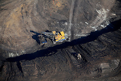 CANADA ALBERTA FORT MCMURRAY 20JUL09 - Aerial view of Suncor Millennium tarsands mine in the Boreal forest north of Fort McMurray, northern Alberta, Canada...The tar sand deposits lie under 141,000 square kilometres of sparsely populated boreal forest and muskeg and contain about 1.7 trillion barrels of bitumen in-place, comparable in magnitude to the world's total proven reserves of conventional petroleum. Current projections state that production will  grow from 1.2 million barrels per day (190,000 m³/d) in 2008 to 3.3 million barrels per day (520,000 m³/d) in 2020 which would place Canada among the four or five largest oil-producing countries in the world...The industry has brought wealth and an economic boom to the region but also created an environmental disaster downstream from the Athabasca river, polluting the lakes where water and fish are contaminated. The native Indian tribes of the Mikisew, Cree, Dene and other smaller First Nations are seeing their natural habitat destroyed and are largely powerless to stop or slow down the rapid expansion of the oil sands development, Canada's number one economic driver...jre/Photo by Jiri Rezac / GREENPEACE..© Jiri Rezac 2009