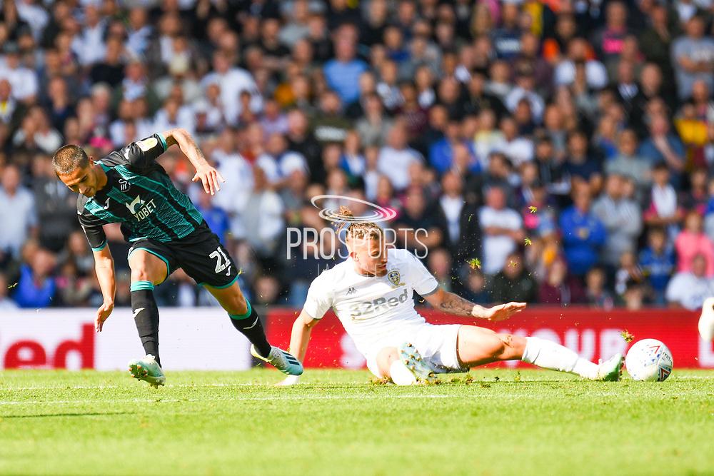 Leeds United midfielder Kalvin Phillips (23) tackles Swansea City midfielder Yan Dhanda (21) during the EFL Sky Bet Championship match between Leeds United and Swansea City at Elland Road, Leeds, England on 31 August 2019.