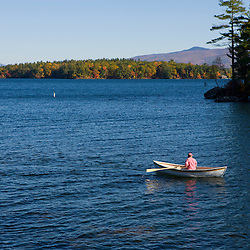 A man rows a boat on Lake Winnipesauke in Meredith, New Hampshire.