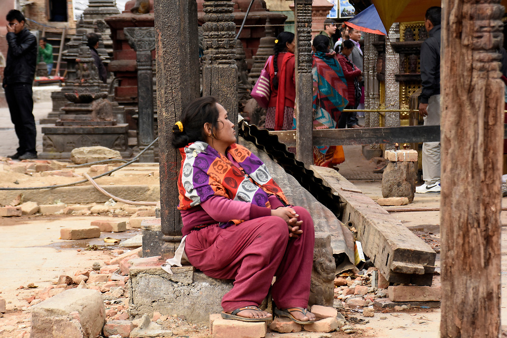 Woman at the Monkey Temple Thinking, and sitting in, Kathmandu