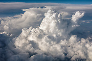Aerial view of the three types of cumulonimbus clouds: Cumulonimbus calvus (FG), Cumulonimbus capillatus (MG) Cumulonimbus incus (BG)