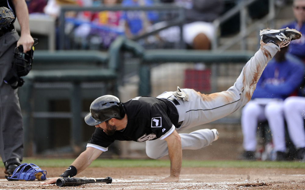 SURPRISE, AZ - MARCH 02:  Adam Eaton #1 of the Chicago White Sox dives back to tag home plate in the first inning against the Texas Rangers on March 2, 2014 at Billy Parker Field at Surprise Stadium in Surprise, Arizona. Eaton was called safe.  (Photo by Ron Vesely)   Subject: Adam Eaton