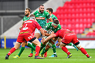 Irne Herbst of Benetton Treviso is tackled by Samson Lee of Scarlets<br /> <br /> Photographer Craig Thomas/Replay Images<br /> <br /> Guinness PRO14 Round 3 - Scarlets v Benetton Treviso - Saturday 15th September 2018 - Parc Y Scarlets - Llanelli<br /> <br /> World Copyright &copy; Replay Images . All rights reserved. info@replayimages.co.uk - http://replayimages.co.uk